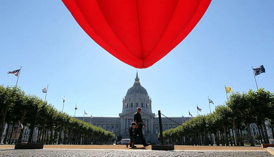 "Lately, the best thing to wake up Civic  Center Plaza is a dancing lotus, ""Breathing Flower"" by Choi Jeong Hwa, which is tied to an exhibition. Photo: Lance Iversen, The Chronicle"