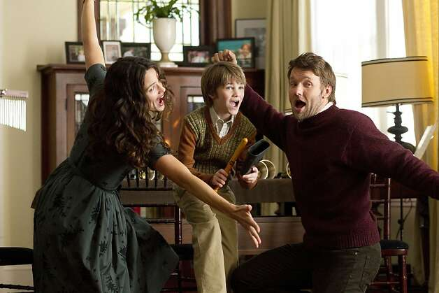 "Jennifer Garner (left) and Joel Edgerton (right) play a couple desperate to adopt in ""The Odd Life Of Timothy Green,"" with C.J. Adams. Photo: Phil Bray, Associated Press"