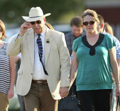 Brazos County Sheriff Chris Kirk, center, arrives for the vigil for Constable Pct. 1 Brian Bachmann at Christ United Methodist Church, Monday, Aug. 13, 2012, in College Station, Texas following a shooting that left three people dead, including Constable Bachmann, near the Texas A&M campus. (AP Photo/Houston Chronicle, Karen Warren) Photo: Karen Warren, Associated Press / Houston Chronicle