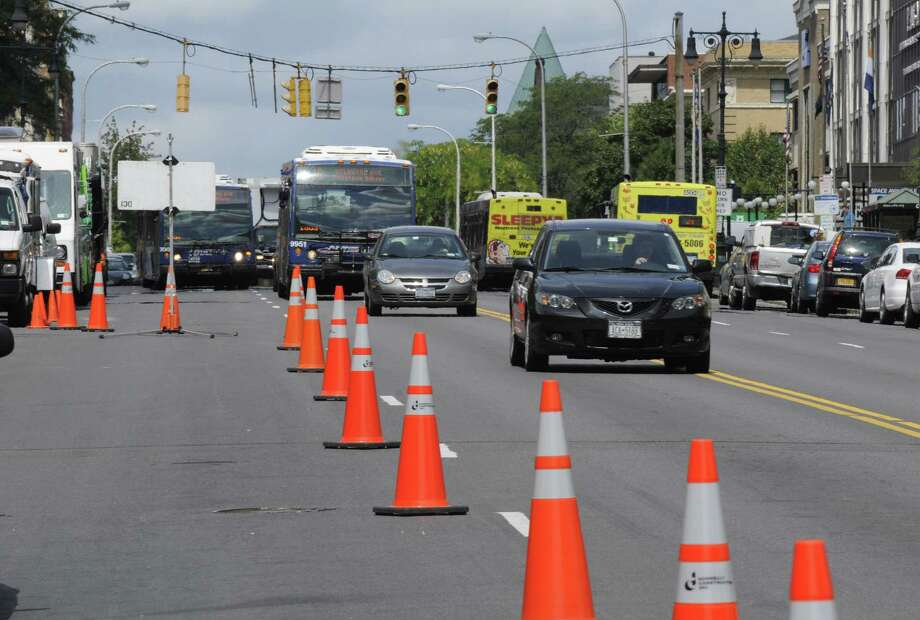 Traffic is reduced to two lanes on Washington Avenue near the state Capitol, Monday, Aug. 13, 2012, in Albany N.Y. The lane shift will be in effect from Monday to Friday to give workers better access while they remove a construction crane at the outside the Capitol.  (Will Waldron / Times Union) Photo: Will Waldron