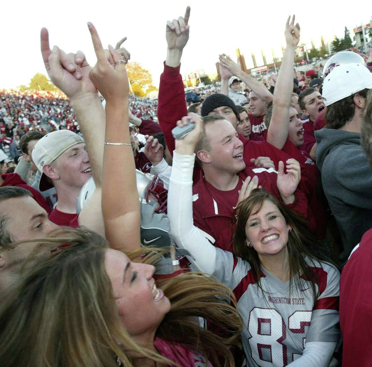 PULLMAN - OCTOBER 21: Washington State Cougars fans celebrate after the Cougars beat the Oregon Ducks 34-23 on October 21, 2006 at Martin Stadium in Pullman.