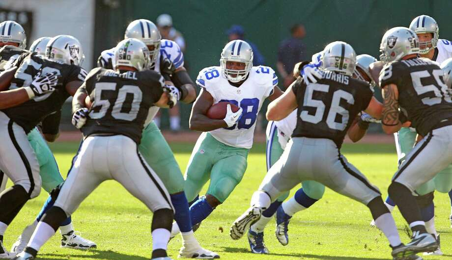 Dallas Cowboys running back Felix Jones (28) gains one yard on this first half play in an NFL preseason game against the Oakland Raiders in Oakland, California on Monday, August 13, 2012. (Ron Jenkins/Fort Worth Star-Telegram/MCT) Photo: Ron Jenkins, McClatchy-Tribune News Service / Fort Worth Star-Telegram