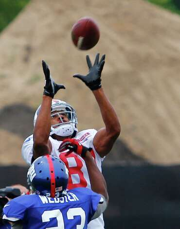 New York Giants wide receiver #87 Domenik Hixon jumps for a pass over cornerback #23 Corey Webster during preseason training camp at UAlbany on Monday Aug. 13, 2012 in Albany, N.Y. (Dan Little/Special to the Times Union) Photo: Dan Little / 00018767D
