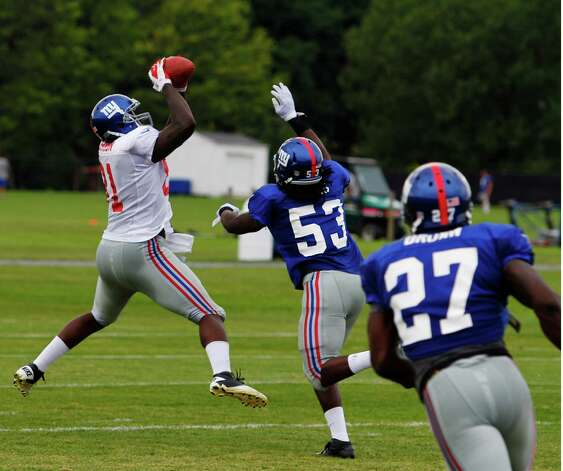New York Giants tight end #81 Adrien Robinson makes a jumping catch over linebacker #53 Greg Jones during preseason training camp at UAlbany on Monday Aug. 13, 2012 in Albany, N.Y. (Dan Little/Special to the Times Union) Photo: Dan Little / 00018767D
