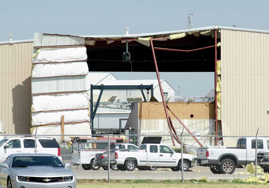 A building at Meacham International Airport in Fort Worth shows the damage caused by Sunday's winds.  Some small planes outside a hangar also were damaged.  Wind gusts of more than 70 mph were recorded Sunday night in the Fort Worth area. Photo: Bob Haynes / The Fort Worth Star-Telegram