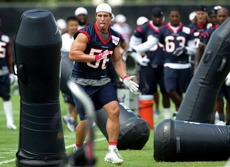 Linebacker Brian Cushing (56) runs though a set of blocking dummies at camp Monday. Cushing was glad to be back after being hospitalized for two nights. Photo: Brett Coomer / © 2012 Houston Chronicle