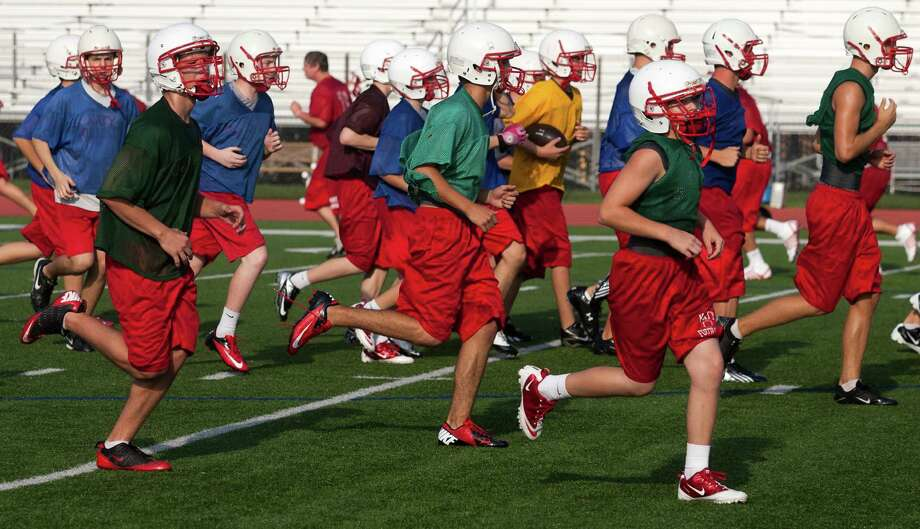 The Katy football team runs through drills during practice on Monday, Aug. 13, 2012, in Katy, TX.  ( J. Patric Schneider / For the Chronicle ) Photo: J. Patric Schneider, Houston Chronicle / © 2012 Houston Chronicle