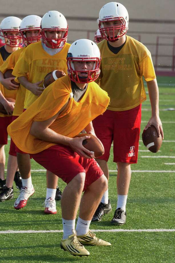 Katy's quarterback Josh Williams runs through drills during practice on Monday, Aug. 13, 2012, in Katy, TX.  ( J. Patric Schneider / For the Chronicle ) Photo: J. Patric Schneider, Houston Chronicle / © 2012 Houston Chronicle