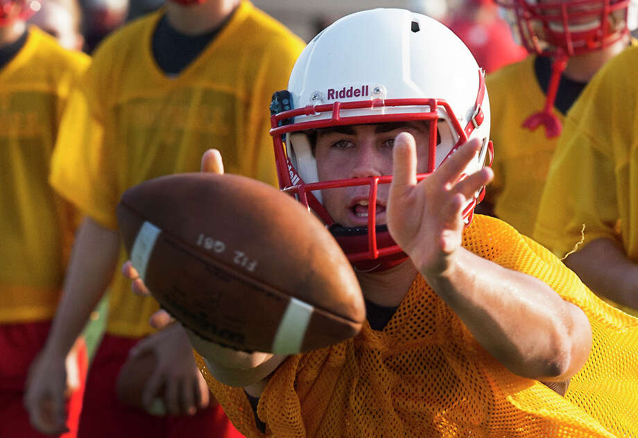 Katy's quarterback Josh Williams pitches the ball during practice on Monday, Aug. 13, 2012, in Katy, TX.  ( J. Patric Schneider / For the Chronicle ) Photo: J. Patric Schneider, Houston Chronicle / © 2012 Houston Chronicle