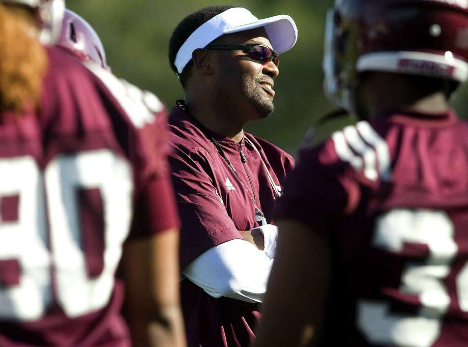 New Texas A&M football coach Kevin Sumlin gathers with his players on the first day of NCAA college fall football practice in College Station, Texas, Friday, Aug. 3, 2012. (AP Photo/Bryan College Station Eagle, Stuart Villanueva) Photo: Stuart Villanueva / Bryan College Station Eagle