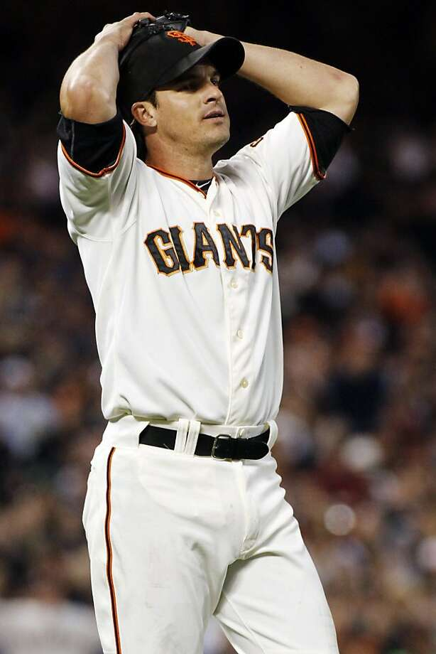San Francisco Giants' Ryan Theriot reacts after not being able to control a ground ball during the third inning of a baseball game against the Washington National, Monday, Aug. 13, 2012, in San Francisco, Calif.  (AP Photo/George Nikitin) Photo: George Nikitin, Associated Press