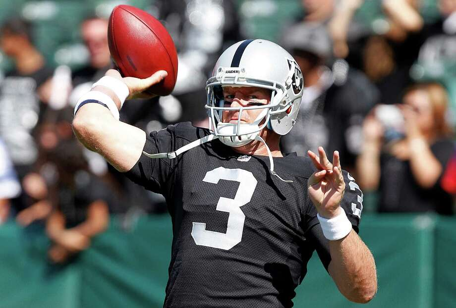 Oakland Raiders quarterback Carson Palmer (3) warms up before an NFL preseason football game against the Dallas Cowboys in Oakland, Calif., Monday, Aug. 13, 2012. (AP Photo/Tony Avelar) Photo: Tony Avelar, Associated Press / FR155217 AP