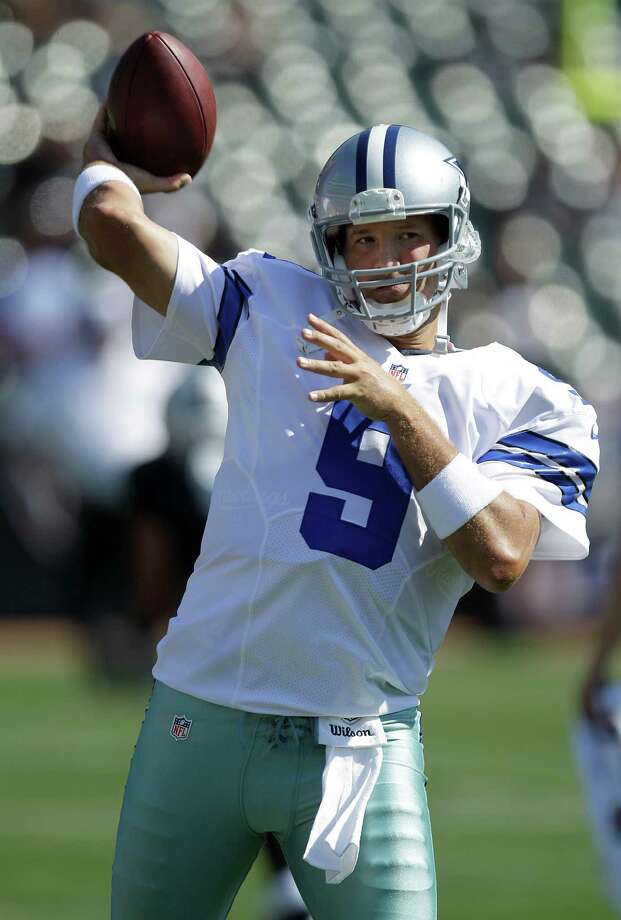 Dallas Cowboys quarterback Tony Romo (9) warms up before an NFL preseason football game against the Oakland Raiders in Oakland, Calif., Monday, Aug. 13, 2012. (AP Photo/Ben Margot) Photo: Ben Margot, Associated Press / AP