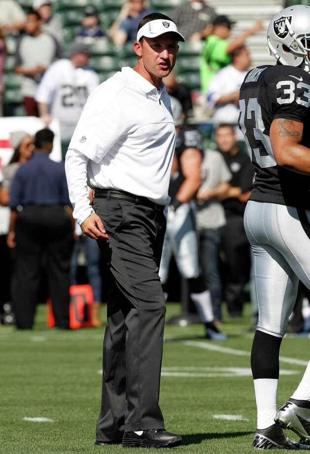 Oakland Raiders head coach Dennis Allen watches as his team warms up before an NFL preseason football game against the Dallas Cowboys in Oakland, Calif., Monday, Aug. 13, 2012. (AP Photo/Tony Avelar) Photo: Tony Avelar, Associated Press / FR155217 AP