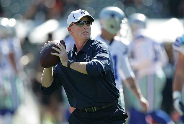 Dallas Cowboys head coach Jason Garrett throws a football before an NFL preseason football game against the Oakland Raiders in Oakland, Calif., Monday, Aug. 13, 2012. (AP Photo/Ben Margot) Photo: Ben Margot, Associated Press / AP