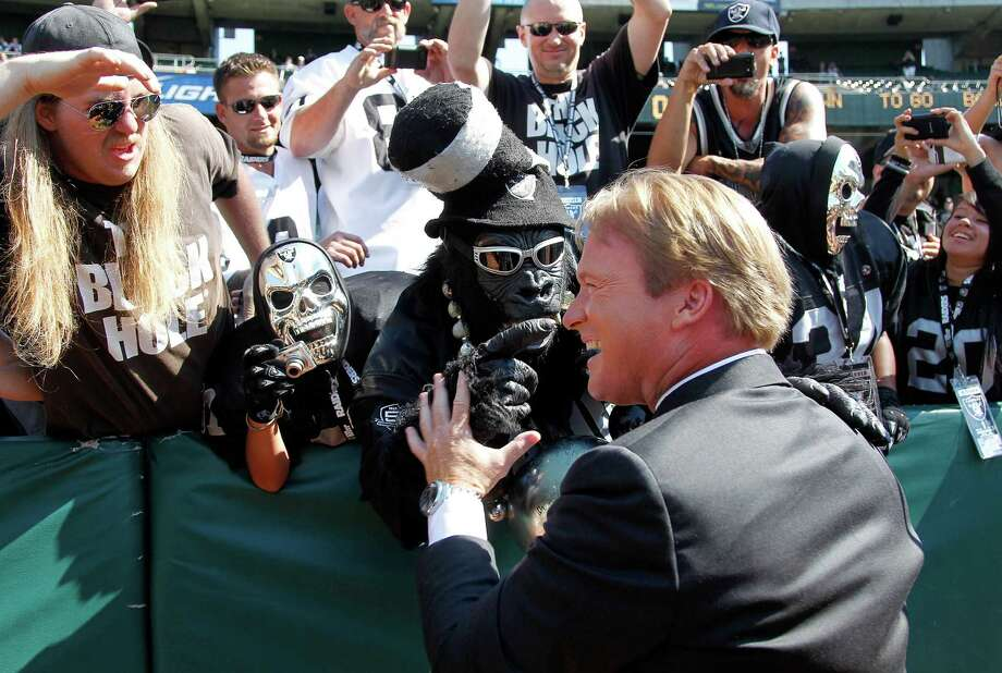 NFL broadcaster and former Oakland Raiders head coach Jon Gruden greets fans before an NFL preseason football game between the Oakland Raiders and the Dallas Cowboys in Oakland, Calif., Monday, Aug. 13, 2012. (AP Photo/Tony Avelar) Photo: Tony Avelar, Associated Press / FR155217 AP