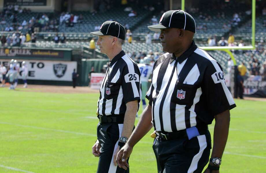 NFL officials are shown before an NFL preseason football game between the Oakland Raiders and the Dallas Cowboys in Oakland, Calif., Monday, Aug. 13, 2012. (AP Photo/Ben Margot) Photo: Ben Margot, Associated Press / AP