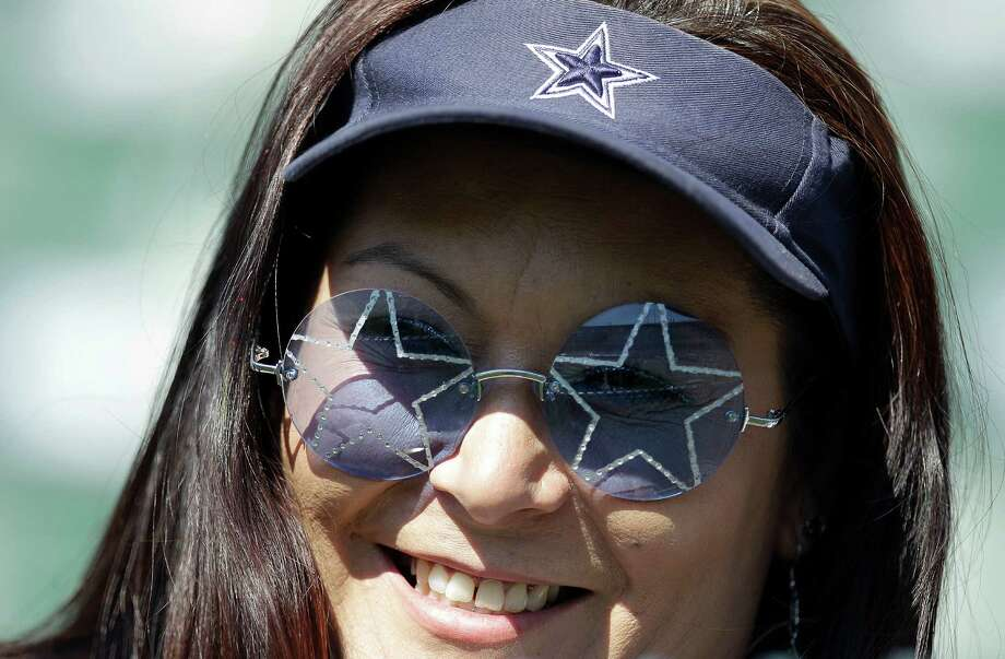 A Dallas Cowboys fan is shown before an NFL preseason football game against the Oakland Raiders in Oakland, Calif., Monday, Aug. 13, 2012. (AP Photo/Ben Margot) Photo: Ben Margot, Associated Press / AP