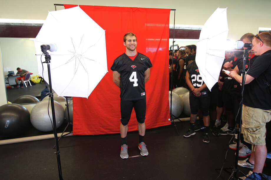The University of the Incarnate Word Cardinals quarterback Zach Rhodes gets his portrait taken during media day at Benson Stadium, Monday, Aug. 13, 2012. Photo: Jerry Lara, San Antonio Express-News / © 2012 San Antonio Express-News