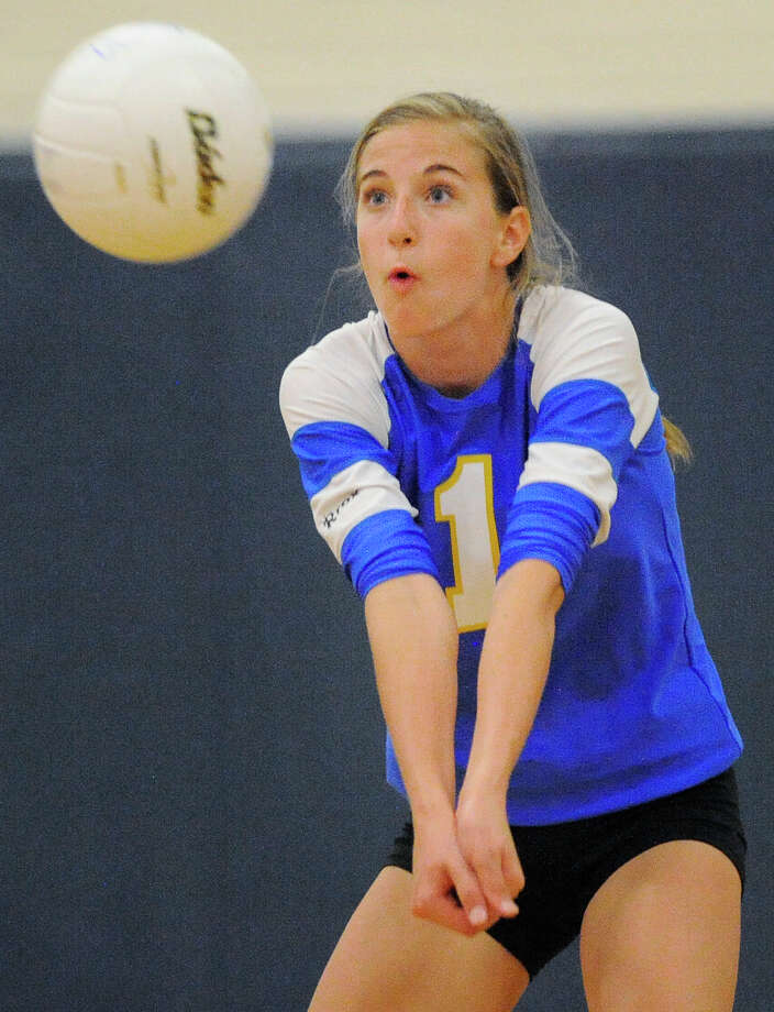 Alamo Heights' Jessica Wellford returns the ball during a high school volleyball game against Antonian, Monday, Aug. 13, 2012, at Alamo Heights High School in San Antonio. Photo: Darren Abate, For The Express-News