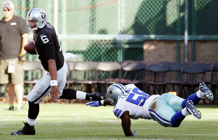 Oakland Raiders quarterback Terrelle Pryor (6) scrambles away from Dallas Cowboys linebacker Orie Lemon (58) during the third quarter of an NFL preseason football game in Oakland, Calif., Monday, Aug. 13, 2012. (AP Photo/Tony Avelar) Photo: Tony Avelar, Associated Press / FR155217 AP