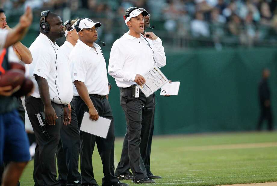 Oakland Raiders head coach Dennis Allen, right, during the second half of an NFL preseason football game against the Dallas Cowboys in Oakland, Calif., Monday, Aug. 13, 2012. (AP Photo/Tony Avelar) Photo: Tony Avelar, Associated Press / FR155217 AP