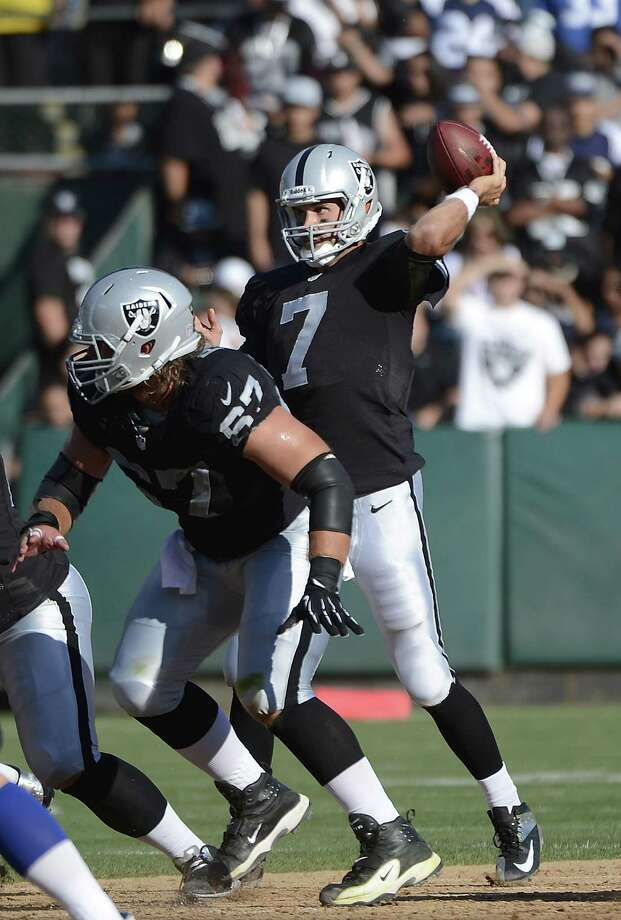 Matt Leinart #7 of the Oakland Raiders drops back to pass against the Dallas Cowboys in the second quarter of an NFL pre-season football game at O.co Coliseum on August 13, 2012 in Oakland, California. Photo: Thearon W. Henderson, Getty Images / 2012 Getty Images
