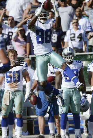 Dez Bryant #88 of the Dallas Cowboys catches an eighteen yard pass from Tony Romo #9 (not pictured) against the Oakland Raiders in the first quarter of an NFL pre-season football game at O.co Coliseum on August 13, 2012 in Oakland, California. Photo: Thearon W. Henderson, Getty Images / 2012 Getty Images