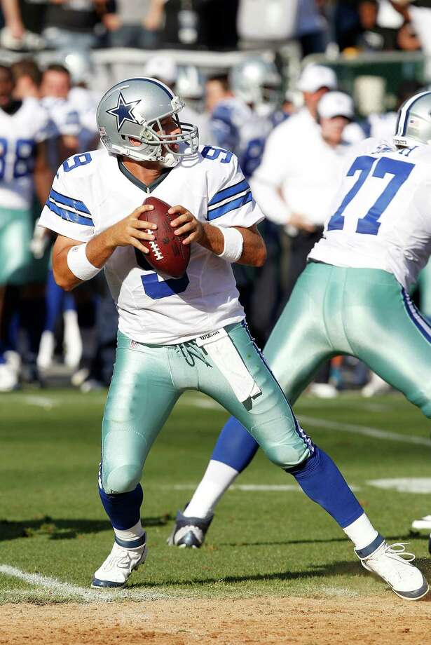 Dallas Cowboys quarterback Tony Romo (9) passes against the Oakland Raiders during the first half of an NFL preseason football game in Oakland, Calif., Monday, Aug. 13, 2012. (AP Photo/Tony Avelar) Photo: Tony Avelar, Associated Press / FR155217 AP