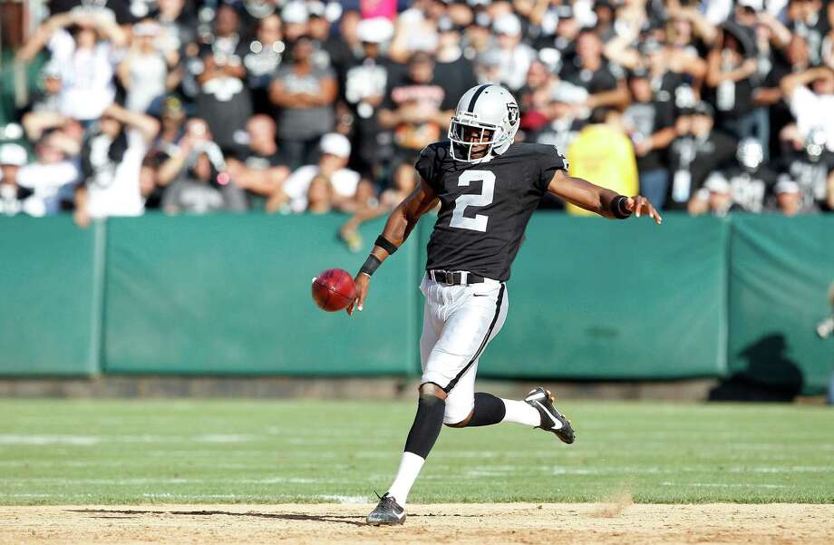Oakland Raiders punter Marquette King (2) punts against the Dallas Cowboys during the first half of an NFL preseason football game in Oakland, Calif., Monday, Aug. 13, 2012. (AP Photo/Tony Avelar) Photo: Tony Avelar, Associated Press / FR155217 AP