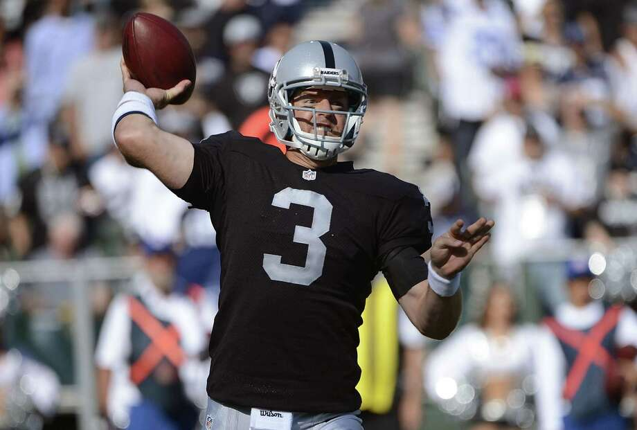 Carson Palmer #3 of the Oakland Raiders drops back to pass against the Dallas Cowboys in the first quarter of an NFL pre-season football game at O.co Coliseum on August 13, 2012 in Oakland, California. Photo: Thearon W. Henderson, Getty Images / 2012 Getty Images