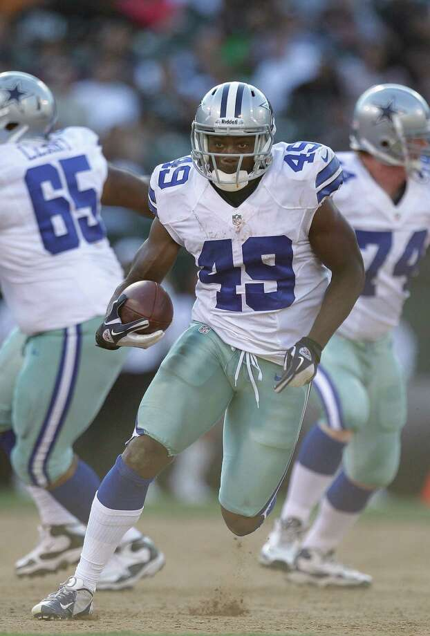 Dallas Cowboys running back Jamize Olawale (49) against the Oakland Raiders during the second half of an NFL preseason football game in Oakland, Calif., Monday, Aug. 13, 2012. (AP Photo/Ben Margot) Photo: Ben Margot, Associated Press / AP
