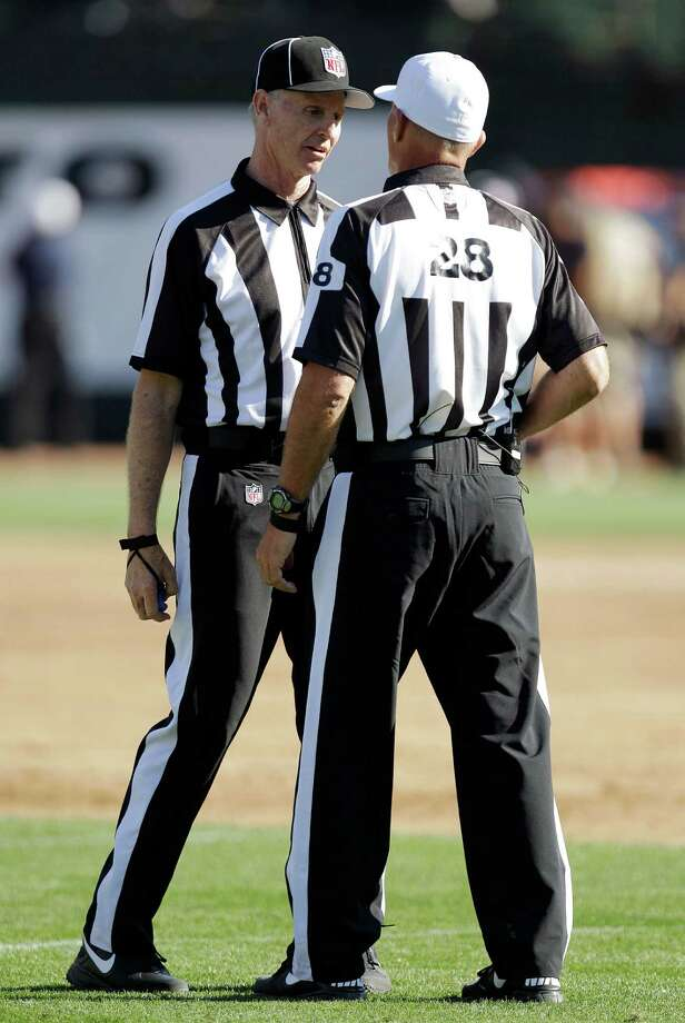 Officials talk during an NFL preseason football game between the Oakland Raiders and the Dallas Cowboys in Oakland, Calif., Monday, Aug. 13, 2012. (AP Photo/Ben Margot) Photo: Ben Margot, Associated Press / AP