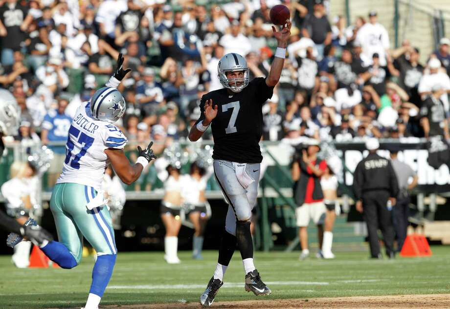 Oakland Raiders quarterback Matt Leinart (7) passes as Dallas Cowboys linebacker Victor Butler (57) pursues during the second quarter of an NFL preseason football game in Oakland, Calif., Monday, Aug. 13, 2012. (AP Photo/Tony Avelar) Photo: Tony Avelar, Associated Press / FR155217 AP