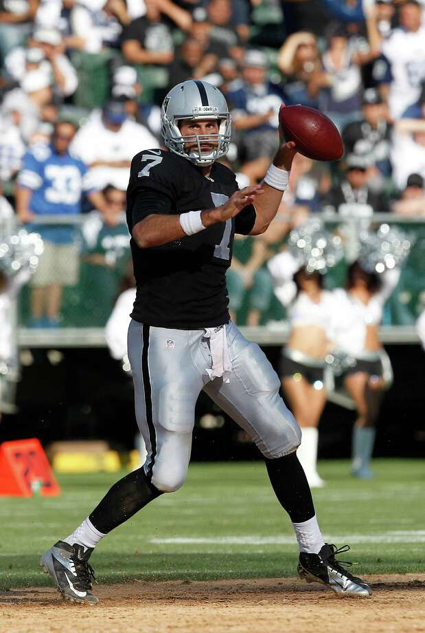 Oakland Raiders quarterback Matt Leinart (7) passes against the Dallas Cowboys during the second quarter of an NFL preseason football game in Oakland, Calif., Monday, Aug. 13, 2012. (AP Photo/Tony Avelar) Photo: Tony Avelar, Associated Press / FR155217 AP