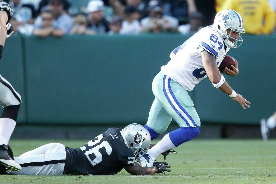 Dallas Cowboys tight end James Hanna (84) runs from Oakland Raiders defensive back Pat Lee (26) during the second half of an NFL preseason football game in Oakland, Calif., Monday, Aug. 13, 2012. (AP Photo/Tony Avelar) Photo: Tony Avelar, Associated Press / FR155217 AP
