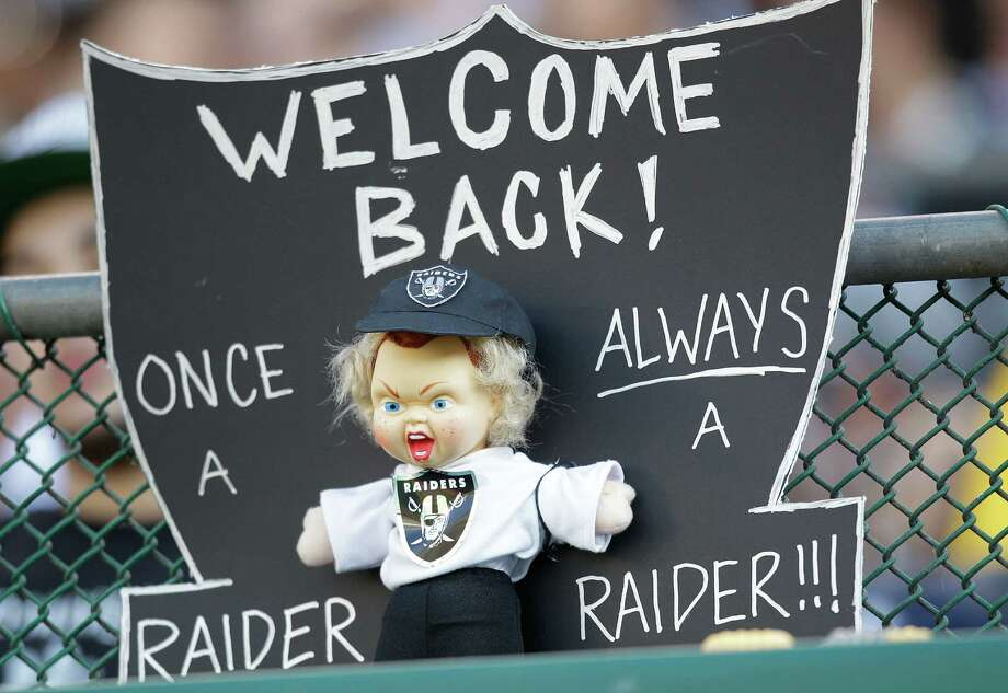 A sign made for NFL broadcaster and former Oakland Raiders head coach Jon Gruden is shown during an NFL preseason football game between the Oakland Raiders and the Dallas Cowboys in Oakland, Calif., Monday, Aug. 13, 2012. (AP Photo/Ben Margot) Photo: Ben Margot, Associated Press / AP