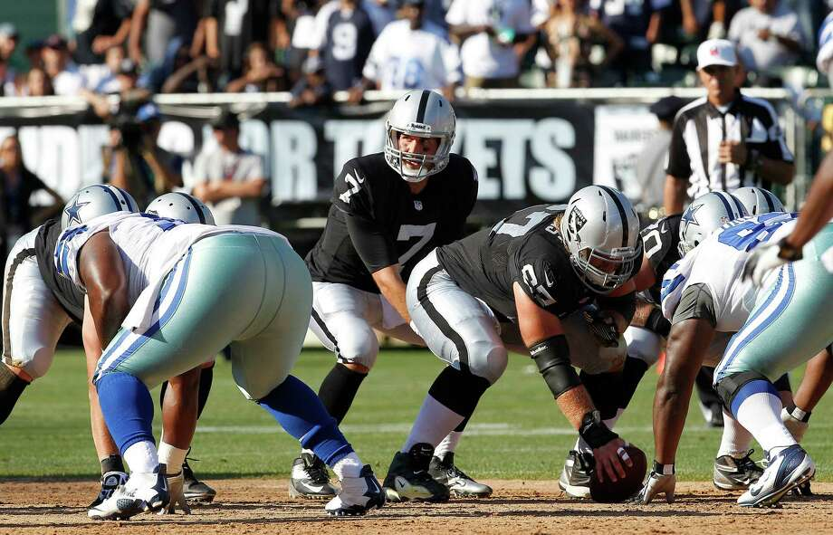 Oakland Raiders quarterback Matt Leinart (7) snaps the ball from guard Alex Parsons (67) during the first half of an NFL preseason football game against the Dallas Cowboys in Oakland, Calif., Monday, Aug. 13, 2012. (AP Photo/Tony Avelar) Photo: Tony Avelar, Associated Press / FR155217 AP