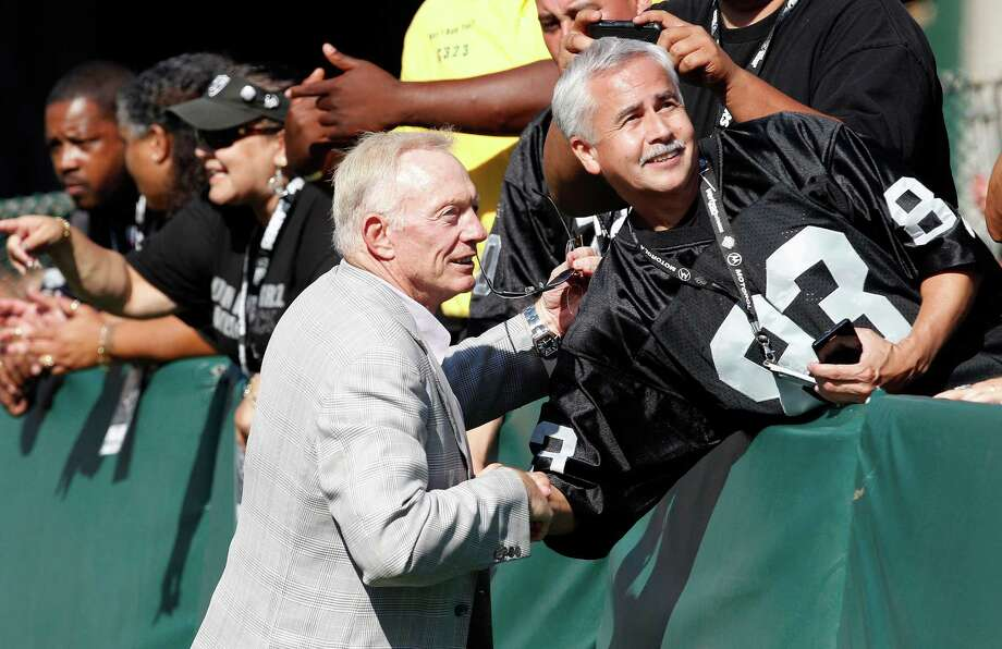 Dallas Cowboys owner Jerry Jones shakes hands with fans before an NFL preseason football game against the Oakland Raiders in Oakland, Calif., Monday, Aug. 13, 2012. (AP Photo/Tony Avelar) Photo: Tony Avelar, Associated Press / FR155217 AP