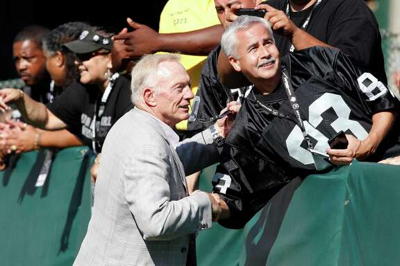 Dallas Cowboys owner Jerry Jones shakes hands with fans before an NFL preseason football game against the Oakland Raiders in Oakland, Calif., Monday, Aug. 13, 2012. (AP Photo/Tony Avelar)