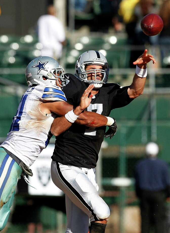 Dallas Cowboys linebacker Kyle Wilber (51) hits Oakland Raiders quarterback Matt Leinart (7) during the second quarter of an NFL preseason football game in Oakland, Calif., Monday, Aug. 13, 2012. (AP Photo/Tony Avelar) Photo: Tony Avelar, Associated Press / FR155217 AP