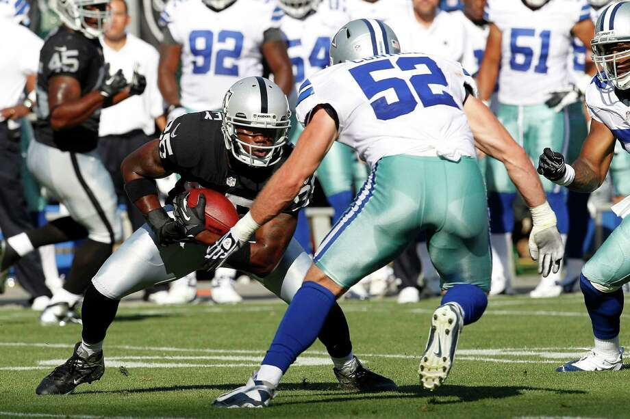 Oakland Raiders wide receiver Darrius Heyward-Bey (85) runs against Dallas Cowboys linebacker Dan Connor (52) during the first quarter of an NFL preseason football game in Oakland, Calif., Monday, Aug. 13, 2012. (AP Photo/Tony Avelar) Photo: Tony Avelar, Associated Press / FR155217 AP