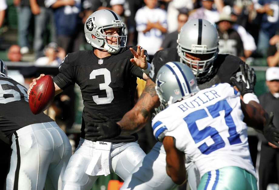 Oakland Raiders quarterback Carson Palmer (3) passes against the Dallas Cowboys during the first quarter of an NFL preseason football game in Oakland, Calif., Monday, Aug. 13, 2012. (AP Photo/Tony Avelar) Photo: Tony Avelar, Associated Press / FR155217 AP