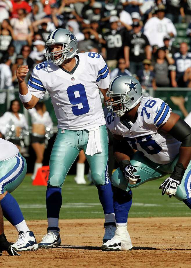 Dallas Cowboys quarterback Tony Romo (9) and guard Derrick Dockery (76) against the Oakland Raiders during the first quarter of an NFL preseason football game in Oakland, Calif., Monday, Aug. 13, 2012. (AP Photo/Tony Avelar) Photo: Tony Avelar, Associated Press / FR155217 AP