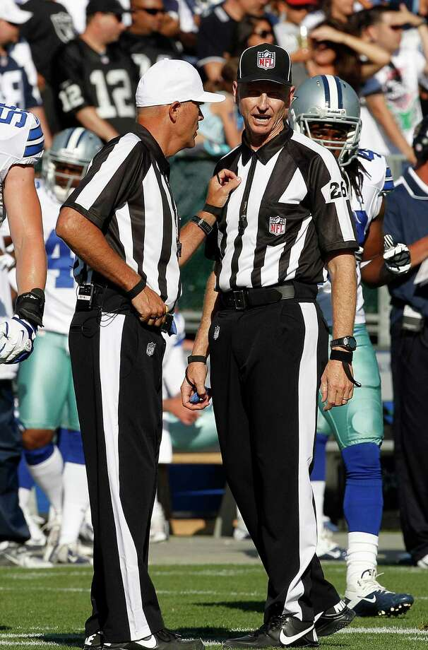 NFL officials talk during an NFL preseason football game between the Oakland Raiders and the Dallas Cowboys in Oakland, Calif., Monday, Aug. 13, 2012. (AP Photo/Tony Avelar) Photo: Tony Avelar, Associated Press / FR155217 AP