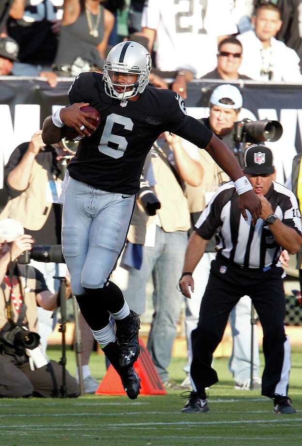 Oakland Raiders quarterback Terrelle Pryor (6) scrambles against the Dallas Cowboys during the third quarter of an NFL preseason football game in Oakland, Calif., Monday, Aug. 13, 2012. (AP Photo/Tony Avelar) Photo: Tony Avelar, Associated Press / FR155217 AP