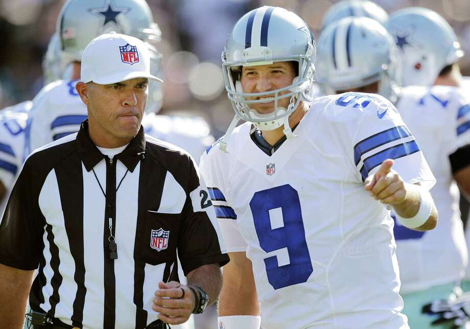 Dallas Cowboys quarterback Tony Romo (9) talks with an official during the first quarter of an NFL preseason football game against the Oakland Raiders in Oakland, Calif., Monday, Aug. 13, 2012. (AP Photo/Ben Margot) Photo: Ben Margot, Associated Press / AP