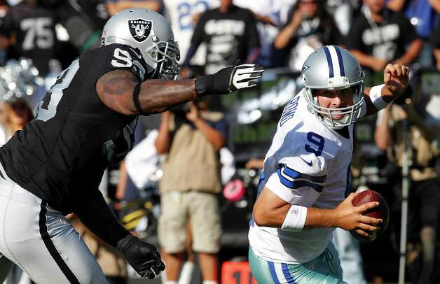 Oakland Raiders defensive tackle Tommy Kelly (93) sacks Dallas Cowboys quarterback Tony Romo (9) during the first quarter of an NFL preseason football game in Oakland, Calif., Monday, Aug. 13, 2012. (AP Photo/Tony Avelar) Photo: Tony Avelar, Associated Press / FR155217 AP