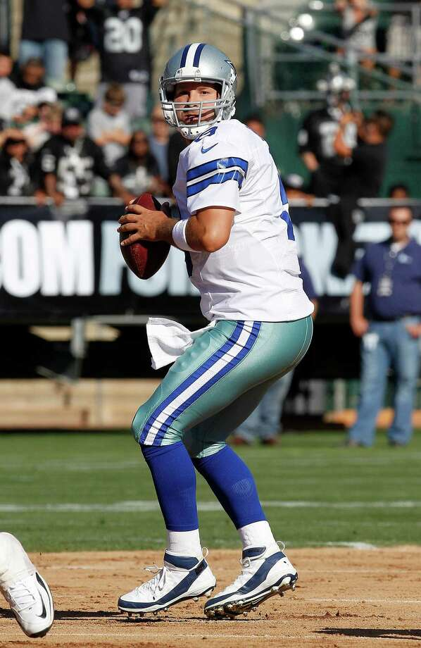 Dallas Cowboys quarterback Tony Romo (9) passes against the Oakland Raiders during the first quarter of an NFL preseason football game in Oakland, Calif., Monday, Aug. 13, 2012. (AP Photo/Tony Avelar) Photo: Tony Avelar, Associated Press / FR155217 AP