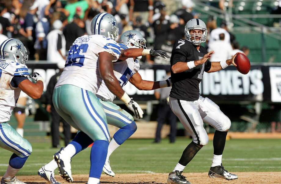 Oakland Raiders quarterback Matt Leinart (7) passes against the Dallas Cowboys during the first half of an NFL preseason football game in Oakland, Calif., Monday, Aug. 13, 2012. (AP Photo/Tony Avelar) Photo: Tony Avelar, Associated Press / FR155217 AP